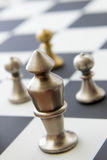 Chess game - view of playing pieces on chessboard Royalty Free Stock Images