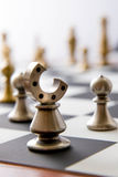 Chess game - view of playing pieces on chessboard Stock Image