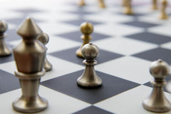 Chess game - view of playing pieces on chessboard Stock Photos