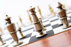 Chess game - view of playing pieces on chessboard Royalty Free Stock Image
