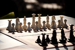 Chess game. White and black Chess pieces on the board. Stock Photos