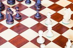 Chess gameplay on chessboard close up. Chess gameplay on wooden chessboard close up royalty free stock photo