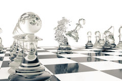 Chess games, victory, success in competition, leadership in business, transparent pawns on a white background, 3d Stock Photo