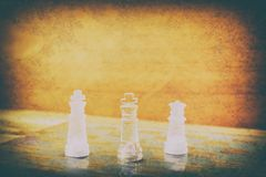 Chess glass on board in game. On a vintage wooden floor background vintage scratched old film colors. Concept competition business. Success. with copy space add stock image