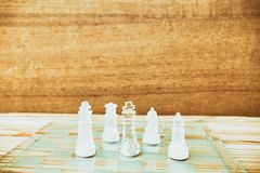 Chess glass on board in game. On a vintage wooden floor background vintage scratched old film colors. Concept competition business. Success. with copy space add royalty free stock images