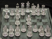 Chess Glass Figures. A shot of chess figures on the board Royalty Free Stock Photos