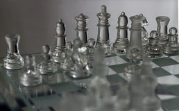 Chess Glass Figures. A shot of chess figures on the board Stock Photos