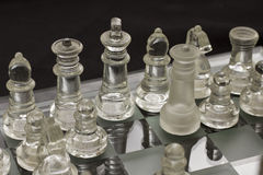 Chess Glass Figures. A shot of chess figures on the board Royalty Free Stock Images