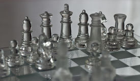 Chess Glass Figures. A shot of chess figures on the board Stock Photo