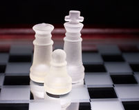 Chess. Glass chess on a glass stand chessboard Royalty Free Stock Photography