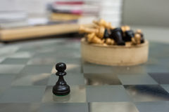 Chess on a glass table. Box with chess on a glass table Royalty Free Stock Photos