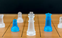 Chess glass on a wood chessboard Stock Photo
