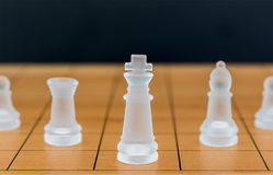Chess glass on a wood chessboard Royalty Free Stock Images