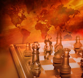 Chess Global Business Strategy. A game of chess with a world map and warm tones Stock Photography