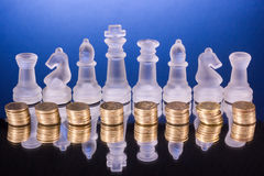Chess on a golden coins. Investment strategy. Finance concept. Royalty Free Stock Image