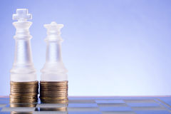 Chess on a golden coins. Investment strategy. Finance concept. Royalty Free Stock Photography