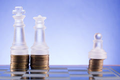 Chess on a golden coins. Investment strategy. Finance concept. Stock Photos