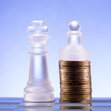 Chess on a golden coins. Investment strategy. Finance concept. Stock Images