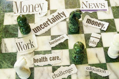 Chess and headlines. Chess pieces and ripped newspaper headlines of current events Stock Images