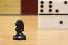 Chess horse closeup on a background of dominoe stock photo