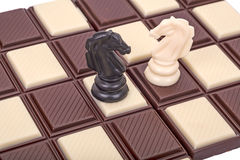 Chess horses on the board of chocolate Stock Images