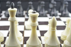 Chess initial state. White figures. Black chess figures. Black and white cells on play board Royalty Free Stock Photography