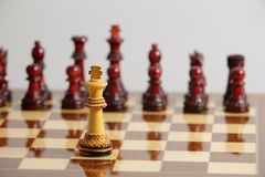 Chess king alone in danger. Challenging in front of its opponent Stock Photos