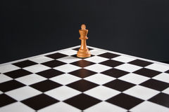 Chess king on board. Chess king in corner of chess board Stock Photography