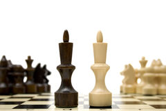 Chess king - confrontation concept. Confrontation between two groups of chess - concept Royalty Free Stock Photography
