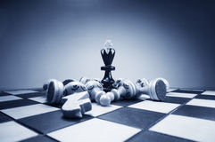 Chess king and fallen figures. Chess king and the fallen figures stock photo