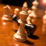Chess king falling Royalty Free Stock Photo