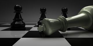 Chess King fell in front of pawns Royalty Free Stock Photography