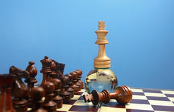 Chess king on globe. White chess king on glass globe . Winner or success  concept Royalty Free Stock Photos