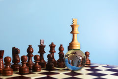 Chess king on globe. White chess king on glass globe . Winner or success  concept Royalty Free Stock Image