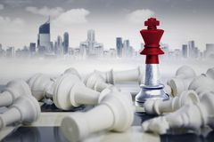 Chess king with Indonesia flag defeating rivals. Image of a chess king with Indonesia flag defeating white chess pieces. Shot with modern city Stock Images
