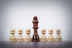Chess king leadership concept over grey background Stock Photos