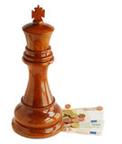 Chess king and money Stock Photography