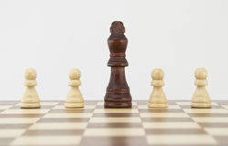 Chess king and pawns on chessboard Royalty Free Stock Images