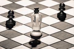 Chess king with pawns Royalty Free Stock Images