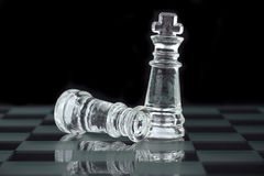 Chess king and queen. Chess king on the chessboard Royalty Free Stock Photo
