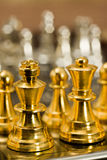 Chess (King and Queen). Chess pieces (king and Queen) on the game board Royalty Free Stock Photography