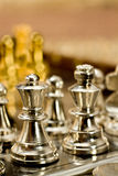 Chess (King and Queen). Chess pieces (king and Queen) on the game board Stock Photography