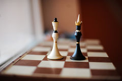 Chess king and queen. Chessboard with figures of the king and the queen Royalty Free Stock Photo
