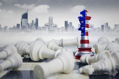 Chess king standing near fallen white chess pieces. Image of chess king with America flag standing near fallen white chess pieces. Shot with modern city Stock Images