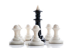 Chess King surrounded by pawns Royalty Free Stock Photography