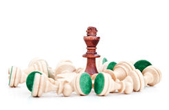 Chess king surrounded by pawns Royalty Free Stock Photos