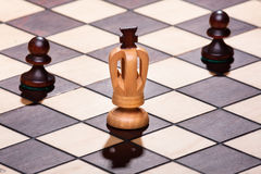 Chess king with two pawns Royalty Free Stock Image