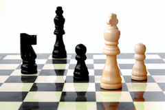 Chess, king under attack. Chess game board, white king under attack Royalty Free Stock Photography