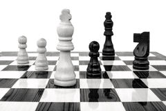 Chess king under attack. White king under attack by a black pawn Stock Photo