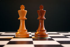 Chess kings on board. Black and white chess kings on chess board Royalty Free Stock Photo